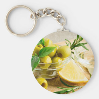 Green pitted olives decorated with herbs keychain