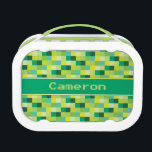 """Green Pixelated Pattern   Personalized Lunch Box<br><div class=""""desc"""">This personalized lunch box features a pixelated pattern of squares in shades of Green with a green stripe and a template area for you to add a name or other custom text. Designed with Geeks and Gamers in mind, the pattern resembles 16 bit images used in many popular video and...</div>"""