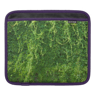 Green plant on a brick wall sleeve for iPads