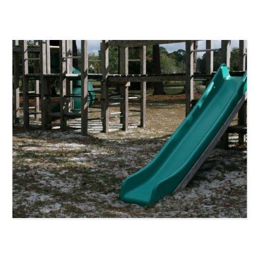Green Playground slide, wood jungle gym Post Card