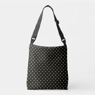 Green polka dots design on black crossbody bag