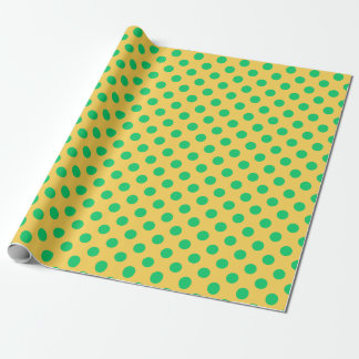 Green polka dots on yellow wrapping paper