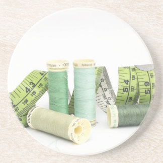 Green sewing kit and threads drink coasters
