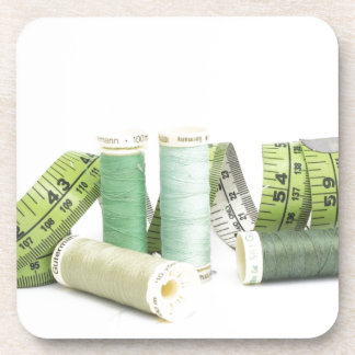 Green sewing kit and threads beverage coaster