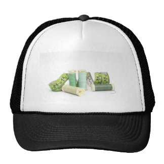 Green sewing kit and threads hats