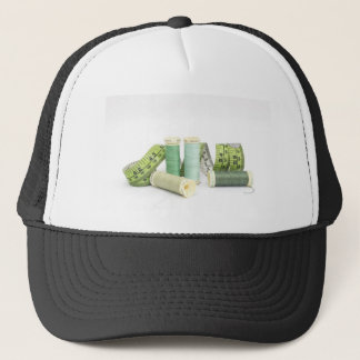 Green sewing kit and threads trucker hat
