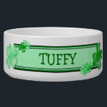"Green Shamrocks Dog Food Bowl With Name Template<br><div class=""desc"">Add your Irish dogs name to this white ceramic bowl.   Green shamrocks decorate the outside with a name plate area for adding the pets name.  Could be for a cat or dog or any pet.</div>"