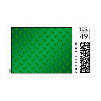 Green shamrock's on green background postage