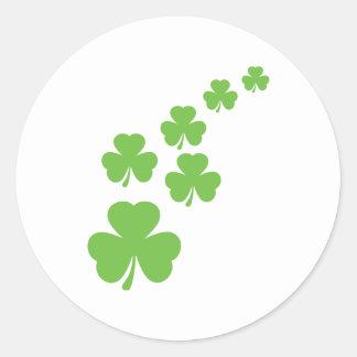 green shamrocks rain classic round sticker