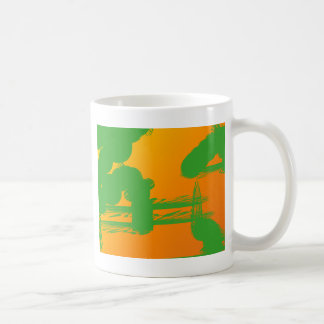 green smudges in orange coffee mugs