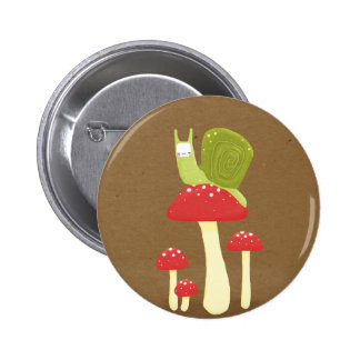 Green snail on red speckled mushrooms button