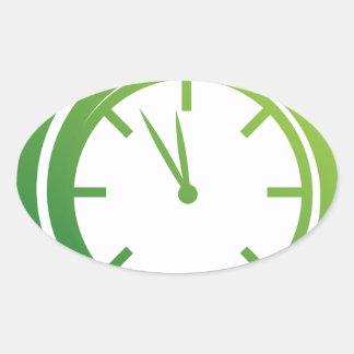 Green Spiral Arrow Spinning Clock Icon Oval Sticker