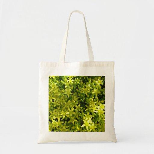 green star like flowers herbal plant tote bag