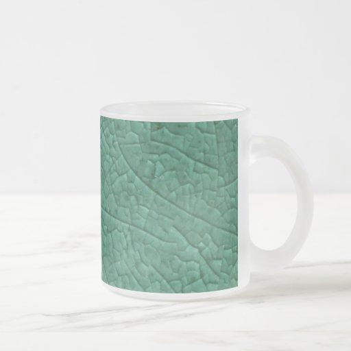 Green stone cracks mugs