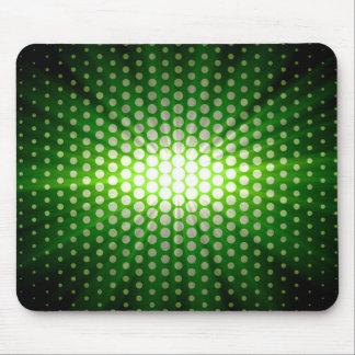 Green sunlight over polka dot mouse pad