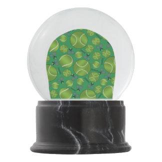 Green tennis balls rackets and nets snow globe