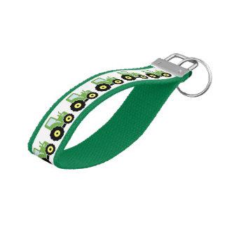 Green toy tractor wrist keychain