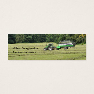 Green tractor trailer collecting silage mini business card