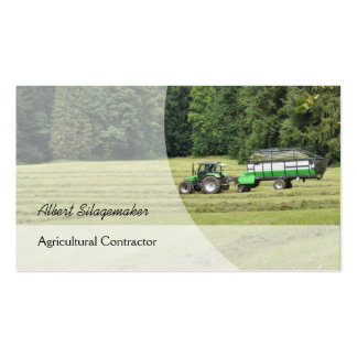 Green tractor with a silage laden trailer business card
