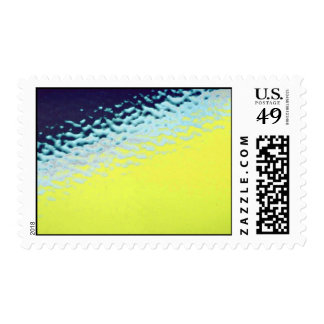 Green with light blue spatter postage stamps