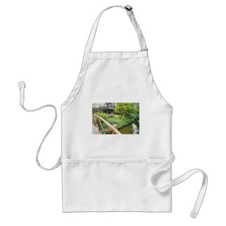 Green Wooden Bridge With View Of River And Garden Aprons
