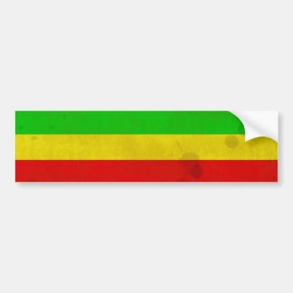 Green, yellow, and red with water stains bumper sticker