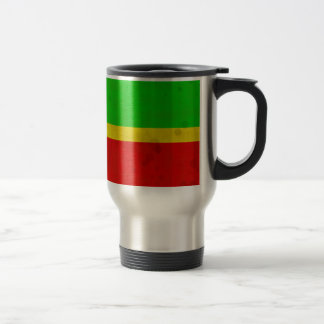 Green, yellow, and red with water stains travel mug