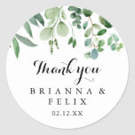 """Greenery Eucalyptus Thank You Wedding Favor Classic Round Sticker<br><div class=""""desc"""">This modern calligraphy thank you wedding favor classic round sticker is perfect for a rustic wedding. The simple and elegant design features classic and fancy script typography in black and white. Make the sticker labels your own by including your names, the event (if applicable), and the date. These stickers can...</div>"""