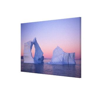 Greenland, Iceberg at sunset. Canvas Print