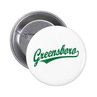 Greensboro script logo in green distressed pinback button
