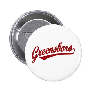 Greensboro script logo in red button
