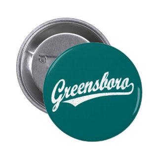 Greensboro script logo in white distressed buttons