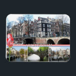 """Greetings from Holland - Amsterdam Flexible Magnet<br><div class=""""desc"""">Greetings from Holland - Amsterdam Flexible Magnet. An Amsterdam cityscape flexible magnet with beautiful photos of the Amsterdam canals, houses and bridges and text &quot;Greetings from Holland&quot; with pink tulips, the Dutch national flag and text &quot;Amsterdam&quot;. This great Amsterdam kitchen magnet is fully customizable, add your texts and images! A...</div>"""