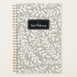 "Greige Sketched Floral Leaf Year and Name Planner<br><div class=""desc"">Start your year off on the right foot with this personalized and chic week and month planner featuring a pattern of hand-drawn white leafy branches and small flowers on a modern greige background. Don&#39;t forget to customize the front with the year and name of your choice!</div>"