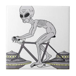 Grey Alien Riding Bike With UFO Wheels Tile
