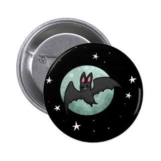 Grey bat flying across silver moon button