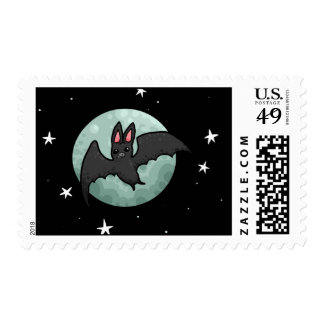 Grey bat flying across silver moon postage stamps