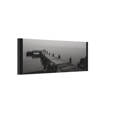 Beach Themed Grey boat dock on a rainy day. canvas print