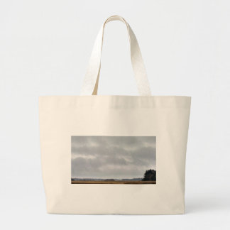 grey clouds above marsh tote bags