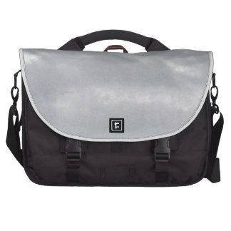 grey clouds above marsh laptop bag