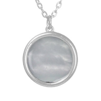 grey clouds above marsh jewelry