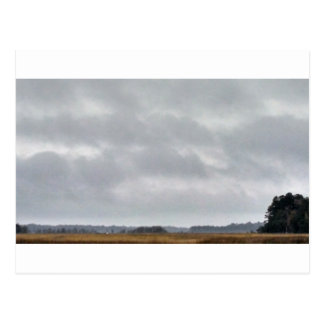 grey clouds above marsh postcard