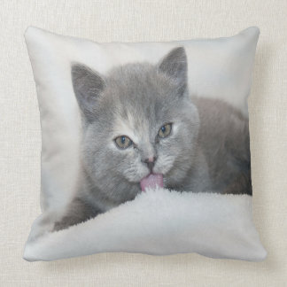 Grey Kitten Licking Snow Throw Pillow