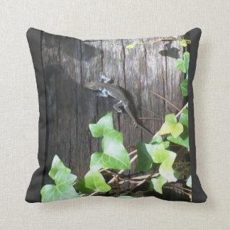 grey lizard in ivy on grey pillow