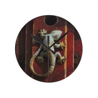 grey lizard on worn wood round wallclocks