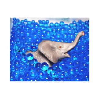 grey plastic elephant in blue balls canvas prints