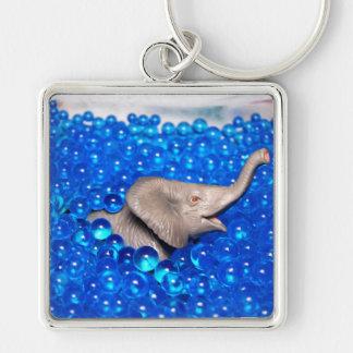 grey plastic elephant in blue balls key chain