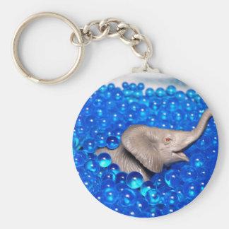 grey plastic elephant in blue balls key chains