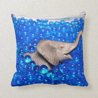 grey plastic elephant in blue balls throw pillow