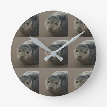Beach Themed Grey seal pup on the beach. Cute baby round clock